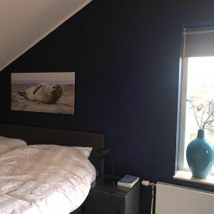 Slaapkamer boven met televisie
